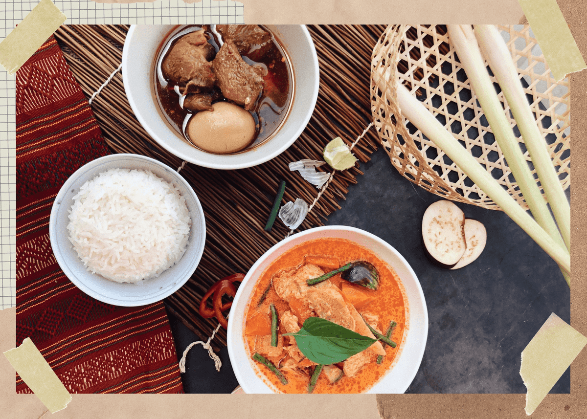 Dining table with vietnamese curry, pork stew, and rice